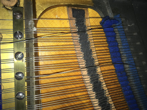 Broken treble piano strings