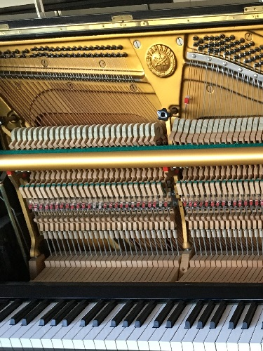 Modern upright piano action
