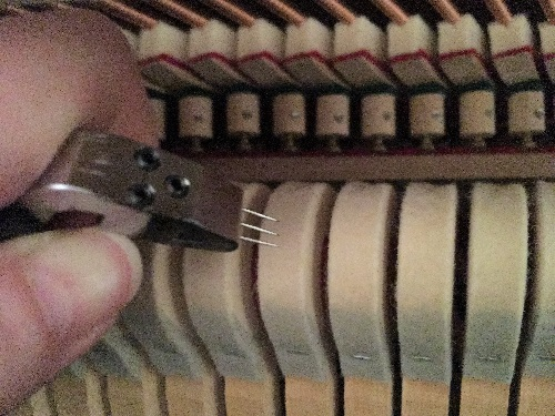 Voicing upright piano hammers
